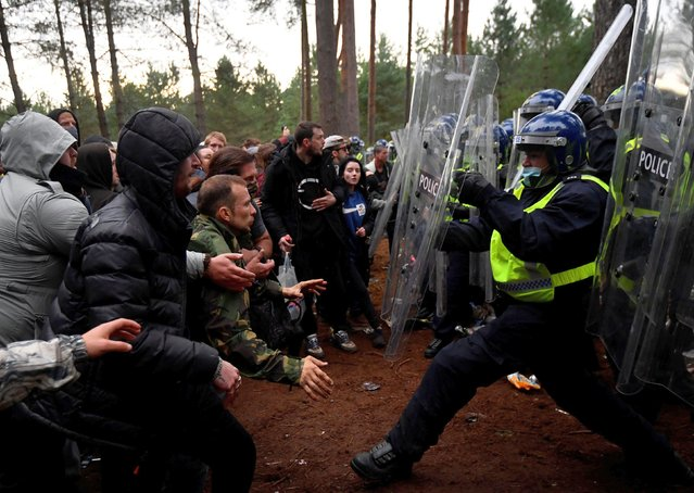 Revellers clash with riot police at the scene of a suspected illegal rave in Thetford Forest, in Norfolk, Britain, August 30, 2020. (Photo by Toby Melville/Reuters)