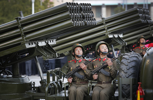 North Korean soldiers parade through Kim Il Sung Square with their missiles and rockets during a mass military parade, Saturday, October 10, 2015, in Pyongyang, North Korea. (Photo by Wong Maye-E/AP Photo)