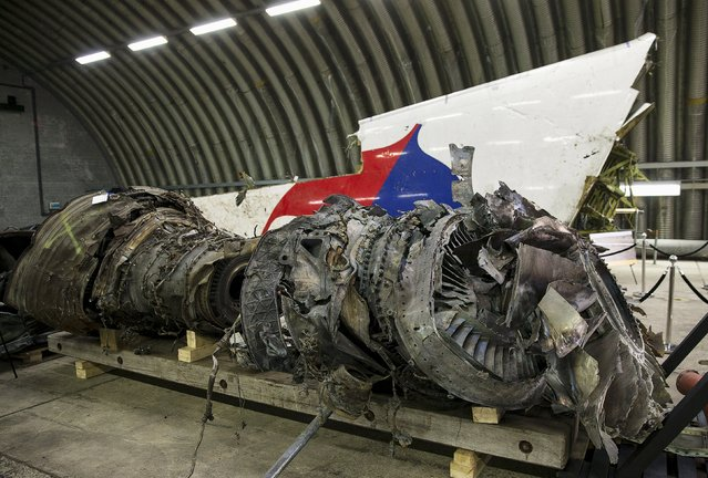 Wreckage of the MH17 airplane is seen after the presentation of the final report into the crash of July 2014 of Malaysia Airlines flight MH17 over Ukraine in Gilze Rijen, the Netherlands, October 13, 2015. (Photo by Michael Kooren/Reuters)