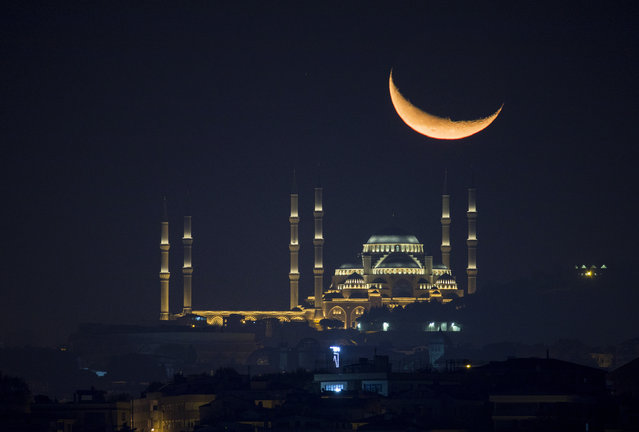 Great Camlica Mosque is seen with moon during night in Istanbul, Turkey on October 12, 2020. (Photo by Isa Terli/Anadolu Agency via Getty Images)