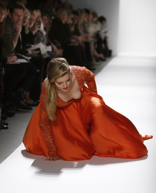 A model falls while presenting a creation at the Dennis Basso Fall/Winter 2012 collection show during New York Fashion Week February 14, 2012. (Photo by Carlo Allegri/Reuters)