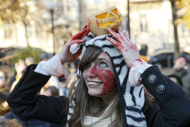 A reveller takes part in a zombie parade to celebrate Halloween in Kiev, Ukraine, October 31, 2015. (Photo by Valentyn Ogirenko/Reuters)