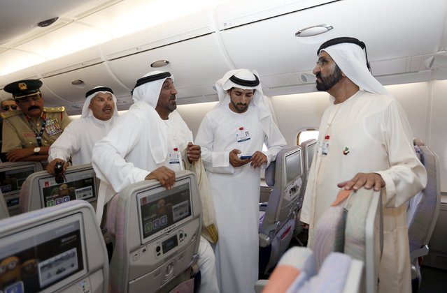 United Arab Emirates Vice President, Prime Minister and Dubai Ruler, Sheikh Mohammed bin Rashid al-Maktoum (R) talks with Sheikh Ahmed bin Saeed Al Maktoum, chairman of Emirates airline during their tour of the Airbus A380 at the  Dubai Airshow November 8, 2015. (Photo by Ahmed Jadallah/Reuters)