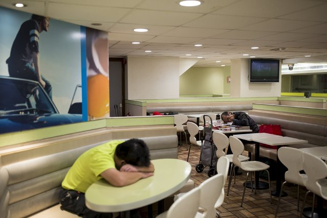 Men sleep at a 24-hour McDonald's restaurant in Hong Kong, China November 10, 2015. A large number of homeless people sleeping on the street has long been been a problem in Hong Kong mainly due to its high rent and soaring property. In recent years, McDonald's 24-hour fast food shops opening all over the city have become popular alternatives for people, know as McRefugees or McSleepers, to spend the night in a safer and more comfortable way than on the street. (Photo by Tyrone Siu/Reuters)