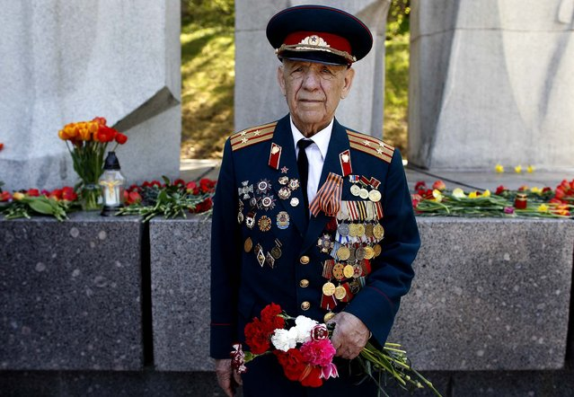 Aleksey Asolski, a 91 -year-old veteran of World War II, joins Victory Day celebrations at the Antakalnis memorial in Vilnius, Lithuania on Thursday. (Photo by Mindaugas Kulbis/Associated Press)
