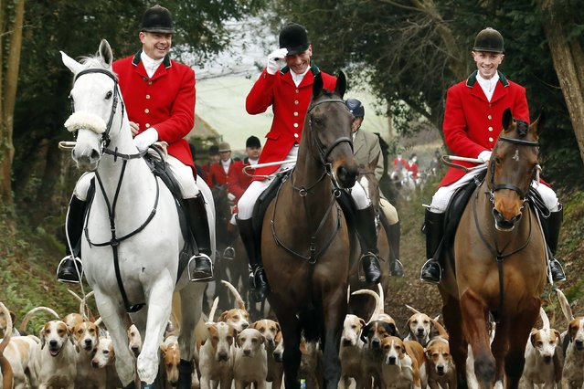 Members of the Old Surrey Burstow and West Kent Hunt ride to Chiddingstone Castle for the annual Boxing Day hunt in Chiddingstone, south east England December 26, 2014. (Photo by Luke MacGregor/Reuters)