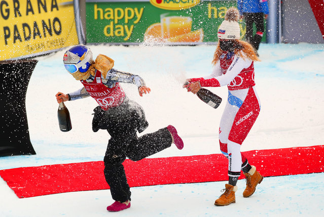 Winner Ester Ledecka of Czech Republic (L) and second placed Corinne Suter of Switzerland (R) celebrate on the podium for the Women's Super-G race at the FIS Alpine Skiing World Cup in Val d'Isere, France, 20 December 2020. (Photo by Guillaume Horcajuelo/EPA/EFE)