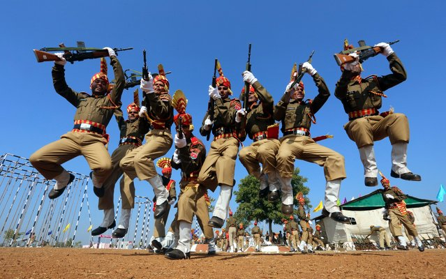 India's Central Armed Police Forces, Sashastra Seema Bal (SSB) personnel jump with joy as they celebrate after their passing out parade at their training headquarters near Bhopal, India, 29 December 2014. Around 430 cadets from seventeen states of the country took part in the convocational parade after completing a rigorous training program. (Photo by Sanjeev Gupta/EPA)
