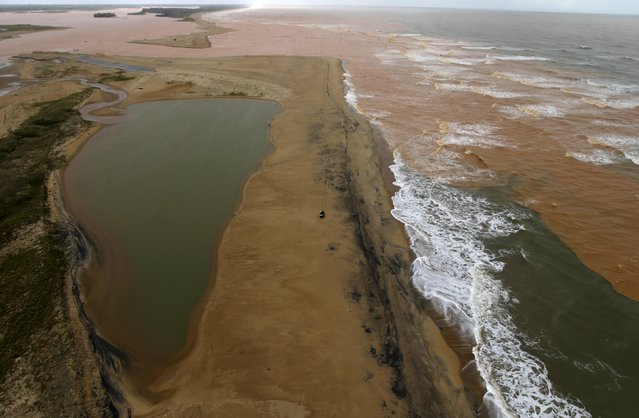 A general view the mouth of  Rio Doce (Doce River), which was flooded with mud after a dam owned by Vale SA and BHP Billiton Ltd burst, as the river joins the sea on the coast of Espirito Santo in Regencia Village, Brazil, November 22, 2015. (Photo by Ricardo Moraes/Reuters)