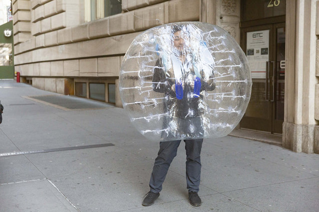 A van in a bubble walking down Broadway near the Charging Bull and Bowling Green in New York on March 24, 2020, amid the COVID-19 Coronavirus pandemic. (Photo by Taidgh Barron/The New York Post)