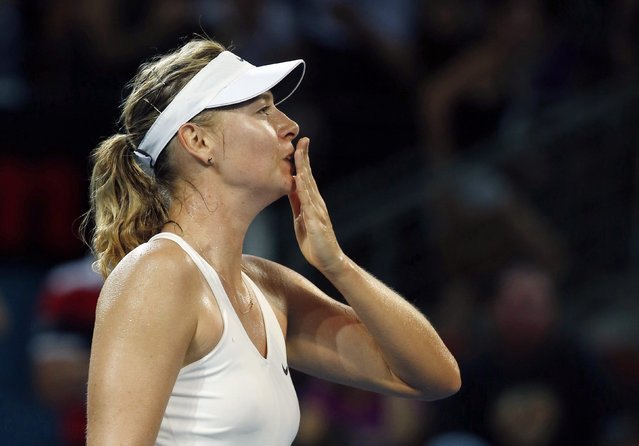 Maria Sharapova of Russia blows a kiss to fans after defeating Elina Svitolina of Ukraine in their women's singles semi final match at the Brisbane International tennis tournament in Brisbane, January 9, 2015. (Photo by Jason Reed/Reuters)