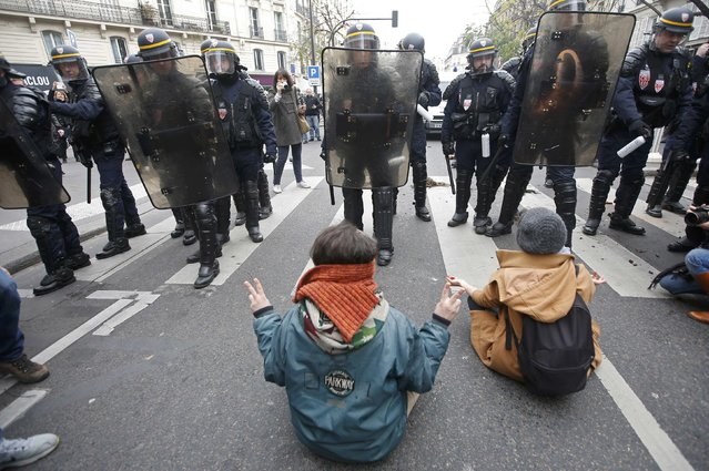 Demonstrators face CRS riot policemen near the Place de la Republique after the cancellation of a planned climate march following shootings in the French capital, ahead of the World Climate Change Conference 2015 (COP21), in Paris, France, November 29, 2015. (Photo by Eric Gaillard/Reuters)