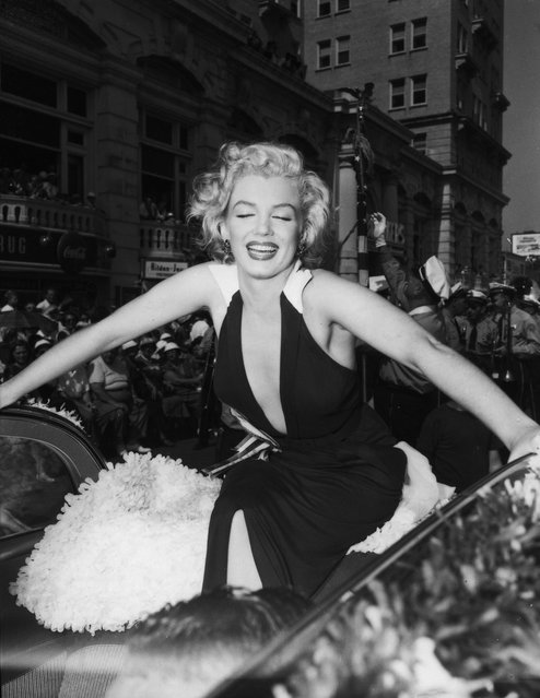 Actress Marilyn Monroe plays grand marshal as she rides on the back of a convertible down the boardwalk during the Miss America Beauty Pageant parade on September 1, 1952 in Atlantic City, New Jersey. (Photo by Michael Ochs Archives/Getty Images)