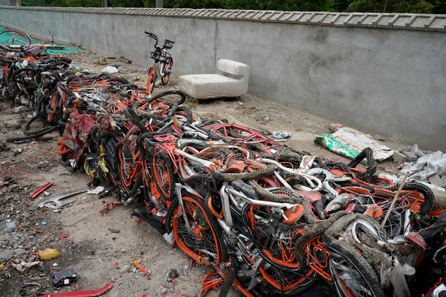 Bicycles of various bike-sharing services compressed into blocks are seen in a garbage dump in Shanghai, China on June 4, 2018. (Photo by Aly Song/Reuters)