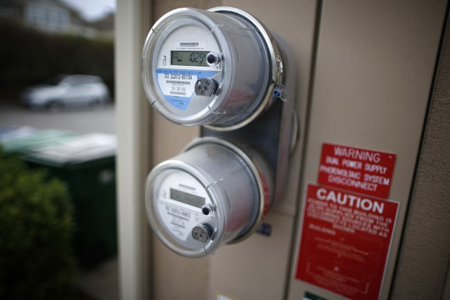 Dual electricity meters are seen outside of computer science professor Christa Lopes' home in Irvine, California January 26, 2015. (Photo by Lucy Nicholson/Reuters)