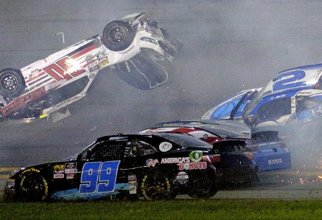 Austin Cindric (60) flips near Ray Black Jr. (99) during a multi-car crash in the NASCAR Xfinity Series auto race at Daytona International Speedway, Friday, July 6, 2018, in Daytona Beach, Fla. (Photo by Dow Graham/AP Photo)