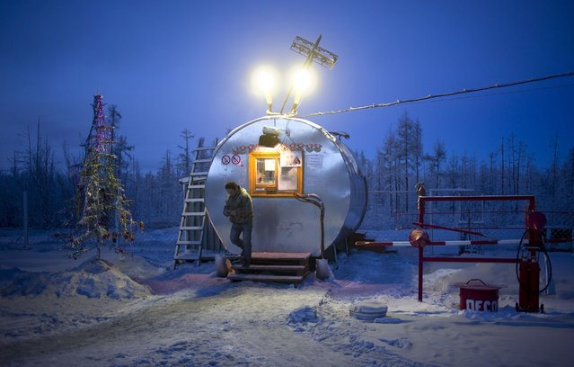 A gas station on the road to the village of Oymyakon, Russia, considered to be the coldest permanently inhabited settlement in the world, January 2013. (Photo by Amos Chapple/REX Features)