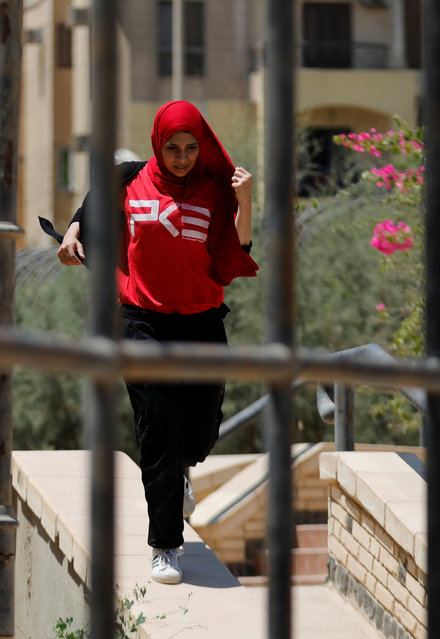 """An Egyptian woman from Parkour Egypt """"PKE"""" in Cairo, Egypt on July 20, 2018. Last year Britain became the first country officially to recognize Parkour as a sport. (Photo by Amr Abdallah Dalsh/Reuters)"""