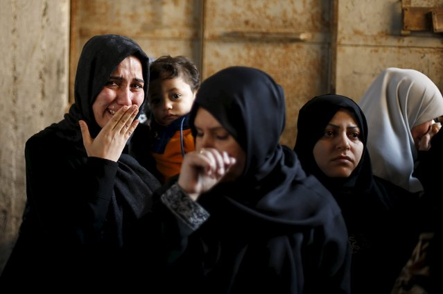 Relatives of Palestinian Hani Wahdan, 22, whom medics said was killed by Israeli troops during clashes with Palestinian protesters on Friday, mourn during his funeral in Gaza City December 26, 2015. (Photo by Suhaib Salem/Reuters)