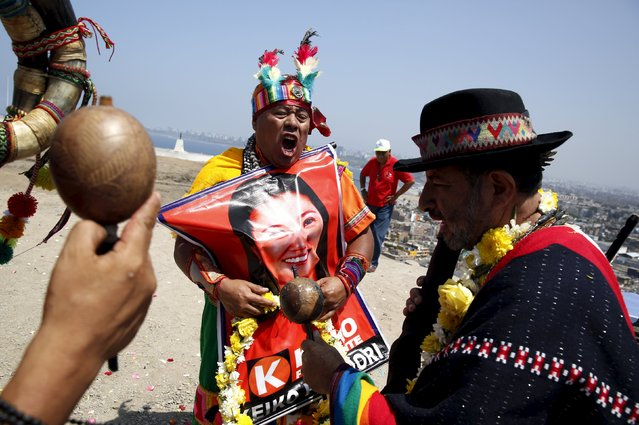 Peruvian shamans holding a poster of Peru's presidential candidate Keiko Fujimori perform a ritual of predictions for the new year at Morro Solar hill in Chorrillos, Lima, Peru, December 29, 2015. (Photo by Mariana Bazo/Reuters)