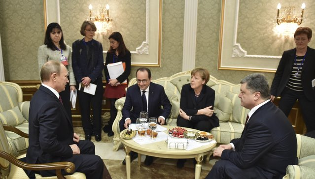 Russia's President Vladimir Putin (L), Ukraine's President Petro Poroshenko (R), Germany's Chancellor Angela Merkel (2nd R) and France's President Francois Hollande attend a meeting on resolving the Ukrainian crisis in Minsk, February 11, 2015. (Photo by Mykola Lazarenko/Reuters)