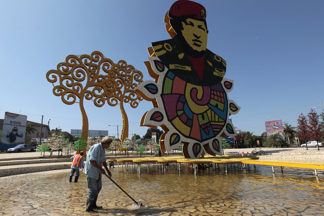 A worker for the Managua mayor's office cleans a monument in honour of late Venezuelan President Hugo Chavez in Managua, Nicaragua February 12, 2015. The Sandinista National Liberation Front prepares to commemorate of the second anniversary of the death of Chavez. (Photo by Oswaldo Rivas/Reuters)