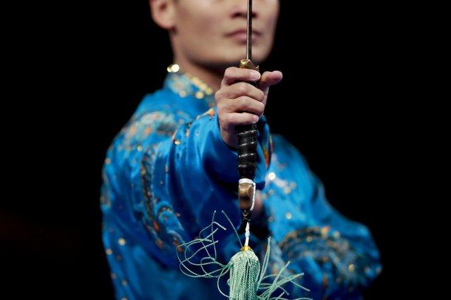 Kazahastan's Askarbay Yedibayev during his taijijian wushu performance at the 18th Asian Games in Jakarta, Indonesia, Wednesday, August 22, 2018. (Photo by Bernat Armangue/AP Photo)