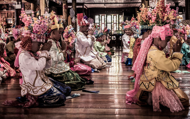 Extravagant floral crowns complete the princely costumes of the novice initiates in Mae Hong Son, Thailand, April 2016. (Photo by Claudio Sieber/Barcroft Images)
