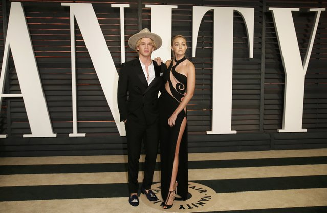 Singer Cody Simpson and model Gigi Hadid arrive at the 2015 Vanity Fair Oscar Party in Beverly Hills, California February 22, 2015. (Photo by Danny Moloshok/Reuters)