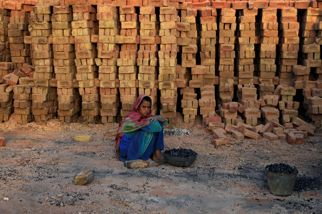 A girl takes a break while working at a brick-making factory on the outskirts of Islamabad, Pakistan October 1, 2018. (Photo by Faisal Mahmood/Reuters)