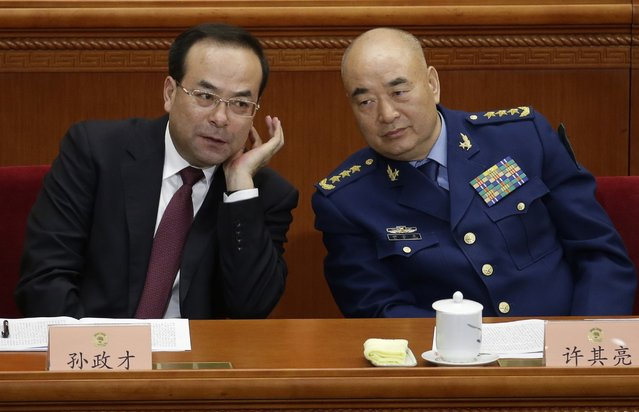 Sun Zhengcai (L), Chongqing municipality Communist Party secretary, and Xu Qiliang, vice chairman of China's Central Military Commission, attend the opening session of the Chinese People's Political Consultative Conference (CPPCC) at the Great Hall of the People in Beijing, March 3, 2015. REUTERS/Jason Lee