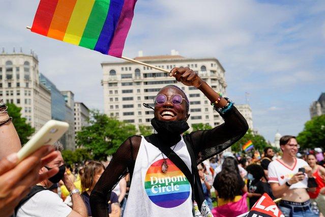 Tolu Igun waves a flag while attending a LGBTQ + Pride event in Washington, U.S., June 12, 2021. (Photo by Erin Scott/Reuters)