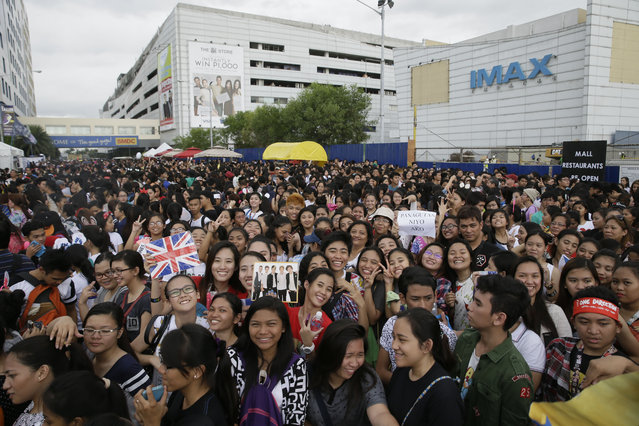Thousands of Filipino fans line up for the One Direction concert Saturday, March 21, 2015 in the suburban Pasay city south of Manila, Philippines. (Photo by Bullit Marquez/AP Photo)