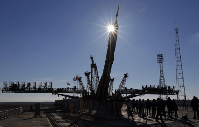 Russia's Soyuz-FG booster rocket with the space capsule Soyuz TMA-16M that will carry a new crew to the International Space Station (ISS) is fixed to the launch pad after arriving from a hangar in Russian leased Baikonur cosmodrome, Kazakhstan, Wednesday, March 25, 2015. (Photo by Dmitry Lovetsky/AP Photo)