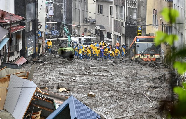Rescuers work as they conduct a search operation at the site of a mudslide in Atami, Shizuoka prefecture, southwest of Tokyo, Sunday, July 4, 2021. A gush of mud swept away homes and cars in the resort town. (Photo by Kyodo News via AP Photo)