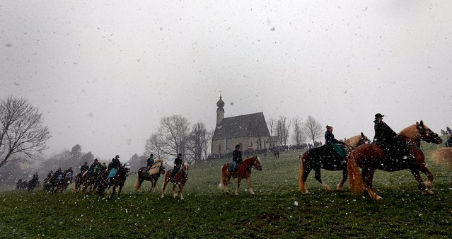 Pilgrims dressed in traditional Bavarian clothes attend the traditional Georgi horse riding procession on Easter Monday in the southern Bavarian town of Traunstein April 6, 2015. (Photo by Michael Dalder/Reuters)