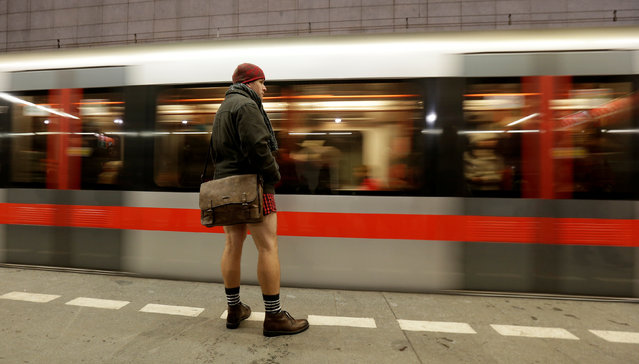 "A passenger not wearing pants waits for a subway train during the ""No Pants Subway Ride"" in Prague, Czech Republic, January 8, 2017. (Photo by David W. Cerny/Reuters)"