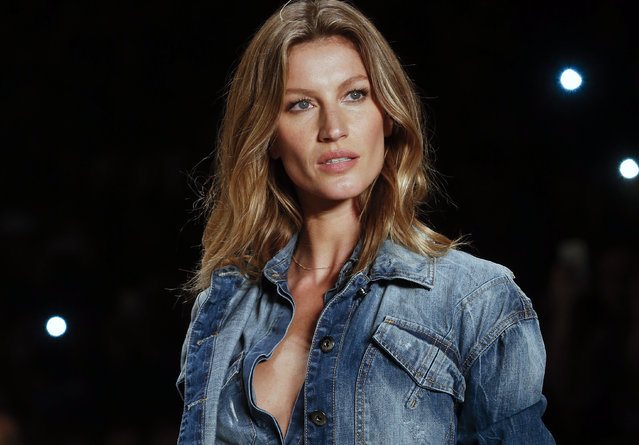 In this November 4, 2014 file photo, Brazilian supermodel Gisele Bundchen wears a creation from the Colcci Winter collection at Sao Paulo Fashion Week in Sao Paulo, Brazil. Bundchen, who has been lighting up catwalks around the world for the past 20 years, is retiring from the runway. The 34-year-old mother-of-two has said her catwalk appearance on Wednesday, April 15, 2015 at Sao Paulo Fashion Week would be the last of her career. (Photo by Andre Penner/AP Photo)