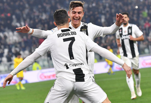 Juventus' Cristiano Ronaldo celebrates with his teammate Paulo Dybala after scoring during the Serie A soccer match between Juventus and Frosinone at the Allianz Stadium in Turin, Italy,  Friday, February 15, 2019. (Photo by Alessandro Di Marco/ANSA via AP Photo)