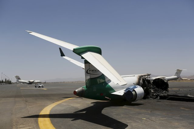 A Felix Airways plane is seen after it was destroyed by an airstrike at the international airport of Yemen's capital Sanaa, April 29, 2015. (Photo by Khaled Abdullah/Reuters)