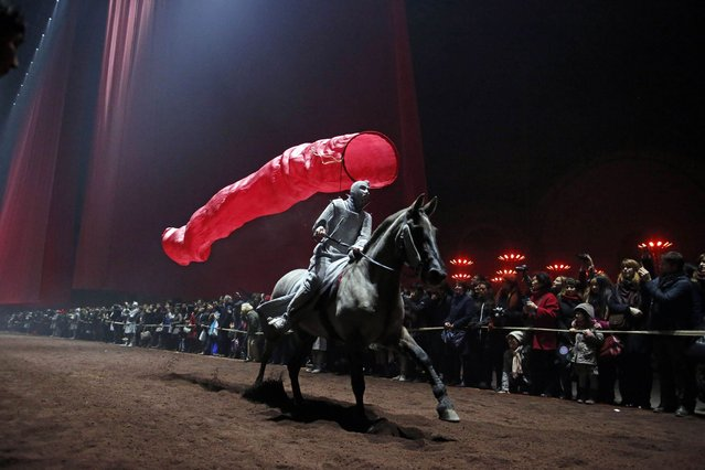 "A performer rides a horse during an equestrian show choreographed by Bartabas for the ""Nuit de Chine"" (Night of China) event at the Grand Palais in Paris, January 27, 2014. This event commemorates the 50th anniversary of the establishment of diplomatic relations between France and China. (Photo by Benoit Tessier/Reuters)"
