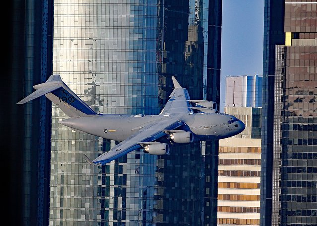 Shocking footage of a low-altitude flight through Brisbane's skyscrapers in United Kingdom on Thursday,  September 23, 2021. The Royal Australian Air Force C-17 cargo jet was spotted on a practice run ahead of the annual Sunsuper Riverfire event, which took place on Saturday night. (Photo by The Mega Agency)
