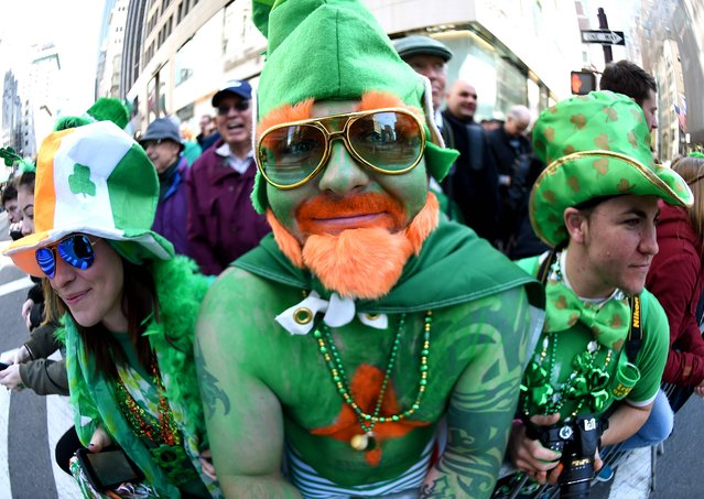 Parade goers pose on 5th Avenue during the 255th New York City St Patrick's Day Parade on March 17, 2016. (Photo by Timothy A. Clary/AFP Photo)