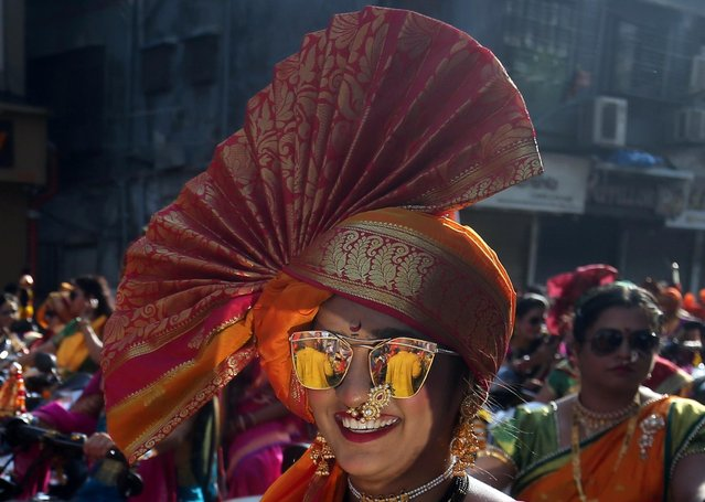 A woman wearing her traditional headgear attends celebrations to mark the Gudi Padwa festival, the beginning of the New Year for Maharashtrians, in Mumbai, April 6, 2019. (Photo by Francis Mascarenhas/Reuters)
