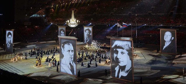 Enormous pictures of Russian authors are displayed in a tribute to the country's literature. (Photo by James Hill/The New York Times)