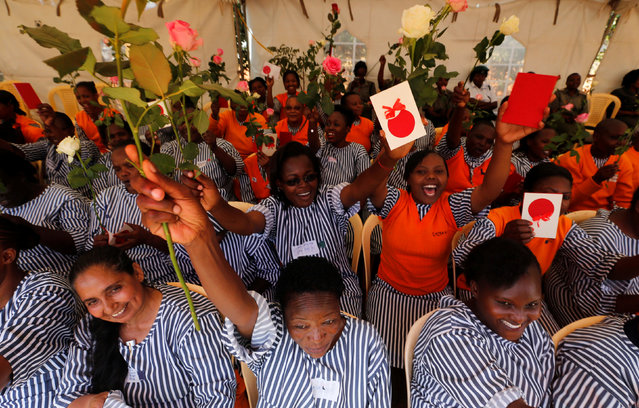 """Female inmates cheer after receiving rose flowers and gifts intended for Valentine's Day, during a celebration dubbed """"love behind bars"""" inside the Langata Women Maximum Security Prison in Kenya's capital Nairobi, February 14, 2017. (Photo by Thomas Mukoya/Reuters)"""