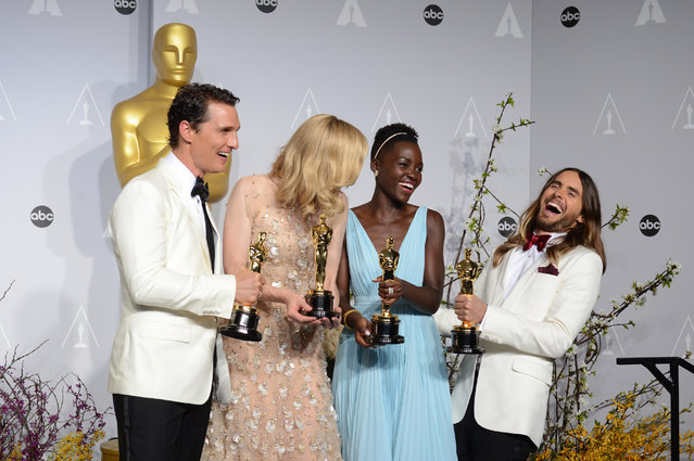 """Matthew McConaughey, from left, holds his award for best actor for his role in """"Dallas Buyers Club"""", Cate Blanchett holds her award for best actress in """"Blue Jasmine"""", Lupita Nyong'o holds her award for best supporting actress for """"12 Years a Slave"""", and Jared Leto holds his award for best supporting actor in """"Dallas Buyers Club"""" in the press room during the Oscars at the Dolby Theatre on Sunday, March 2, 2014, in Los Angeles. (Photo by Jordan Strauss/AP Photo/Invision)"""