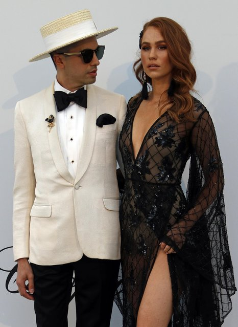 DJ Cassidy poses with Kelsey Evenson for photographers upon arrival at the amfAR, Cinema Against AIDS, benefit at the Hotel du Cap-Eden-Roc, during the 72nd international Cannes film festival, in Cap d'Antibes, southern France, Thursday, May 23, 2019. (Photo by Eric Gaillard/Reuters)