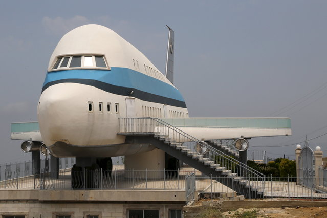 An airplane house is pictured in the village of Miziara, northern Lebanon May 12, 2015. Miziara prides itself on building residential homes that resemble ancient Greek temples and Egyptian ruins, one is even built in the shape of an Airbus A380. (Photo by Aziz Taher/Reuters)