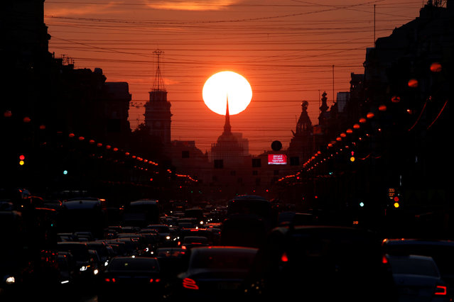 Cars are seen stuck in a traffic jam on Nevsky Prospekt, the city's main thoroughfare, during sunset in St. Petersburg, Russia on September 3, 2018. (Photo by Anton Vaganov/Reuters)